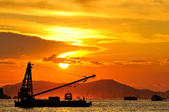 Cargo ship at sunset Stock Photos