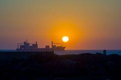 Cargo ship at sunset Stock Photography