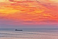 Cargo ship at sunset Stock Photos