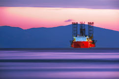 Cargo Ship in Sunset colors Royalty Free Stock Photography