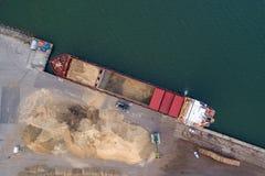 Cargo ship at sunset royalty free stock image
