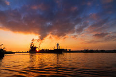 Cargo ship sunset Royalty Free Stock Photos