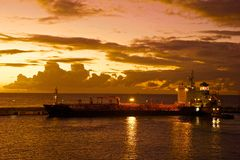 Cargo ship on a sunset, St Barbados Royalty Free Stock Image