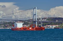 First Bosporus Bridge connecting Europe and Asia, Outdoor Istanb. Cargo ship tanker in the Channel Bosphorus Strait international logistic sea, First Bosporus Royalty Free Stock Photo