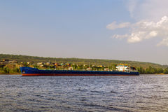 Cargo ship tanker sailing along the coast. Royalty Free Stock Images