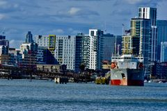 Cargo ship on the thames river royalty free stock photo