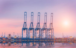 Cargo ship in Trade Port , Container loading Shipping by crane Stock Photo