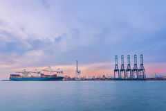 Cargo ship in Trade Port , Container loading Shipping by crane Royalty Free Stock Photography