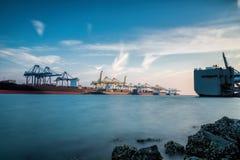 Cargo ship at Trade Port harbor with crane Stock Photography