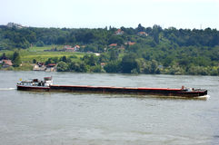 Cargo ship transportation on the river Danube Royalty Free Stock Images