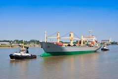 Cargo Ship With two Tugboat Royalty Free Stock Images