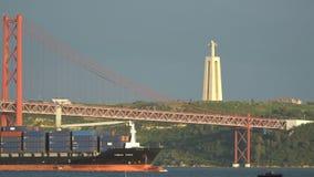Cargo ship under the bridge.  stock video