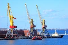 Cargo ship under crane Royalty Free Stock Photo