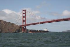 A cargo ship under Golden Gate Bridge stock image