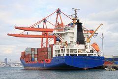 Cargo ship under loading stock photo