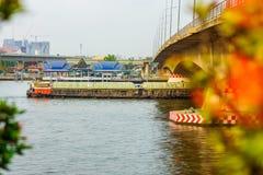 Cargo Ship under road bridge on Chao Phraya river Stock Photo