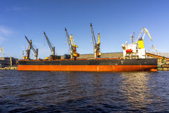 Cargo ship unloading Stock Images
