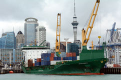 Cargo ship unloading containers in Ports of Auckland New Zealand Royalty Free Stock Image