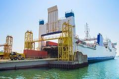 Cargo ship unloading Royalty Free Stock Photography