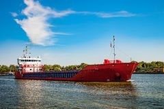 Cargo ship on the way Stock Images