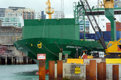 Cargo ship workers unloading containers in Ports of Auckland Stock Images