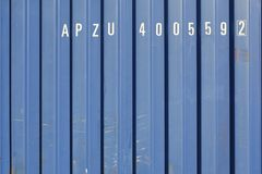 Cargo shipping container with random white letters. Industrial Corrugated Metal with random white lettering royalty free stock photos