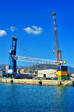 Cargo shipping, cranes in Genova industrial port, Italy Stock Photo