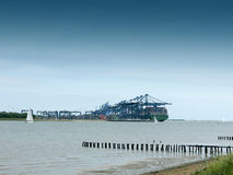 Cargo shipping industry landscape river coast. Essex; UK Royalty Free Stock Photos