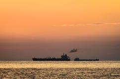 Cargo ships at anchor Stock Photo