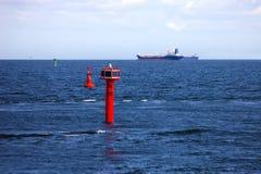 Cargo Ships And Buoy Royalty Free Stock Photos