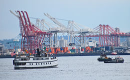 Cargo ships being loaded with containers, Port of Seattle Royalty Free Stock Photo