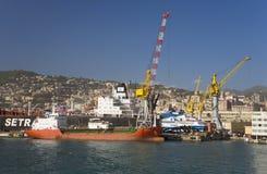 Cargo ships being loaded in Genoa Harbor, Genoa, Italy, Europe Stock Photo