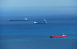 Cargo ships in blue sea Royalty Free Stock Photography