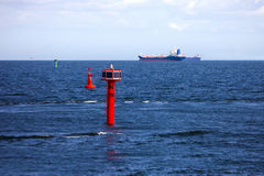Cargo ships and buoy Royalty Free Stock Photos