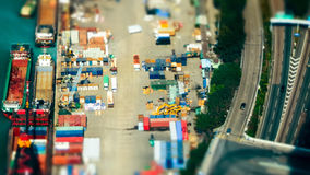 Cargo ships with containers at port terminal. Hong Kong. Tilt shift Royalty Free Stock Photos