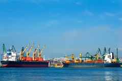 Cargo ships with cranes. Royalty Free Stock Photography