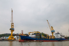 Cargo ships and cranes at the Whampoa  pier in Whampoa  port, Guangzhou. This is an important pier in Guangzhou, there are maintenance of the royalty free stock image