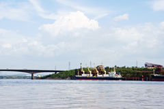 Cargo ships. Dock for cargo ships at the mouth of the Caroni River in the Orinoco, Ciudad Guayana, Bolivar State, Venezuela Stock Image