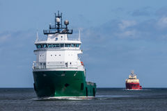 Cargo Ships entering harbour Royalty Free Stock Images
