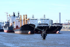 Cargo ships in harbour Royalty Free Stock Photography
