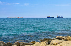 Cargo ships on horizon. Cargo ships in the sea on horizon Royalty Free Stock Images