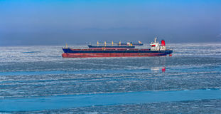 Cargo ships in ice Royalty Free Stock Photo