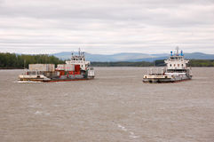 Cargo ships at Kolyma river Russia outback Royalty Free Stock Photos