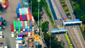 Cargo ships loaded by crane with cargo containers at a busy port terminal. Hong Kong. Tilt Shift. Time lapse stock video
