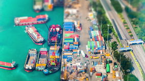 Cargo ships loaded by crane with cargo containers at port terminal. Hong Kong stock footage