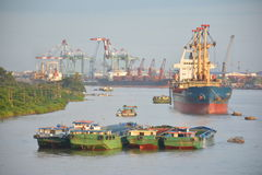 Cargo Ships on Mekong. Cargo Ships and heavy load boats on the river in Mekong Delta Stock Photo