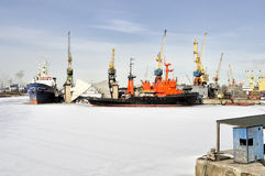 Cargo ships moored to port in the winter time Royalty Free Stock Photography