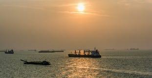 Cargo ships passes Strait of Singapore Royalty Free Stock Image