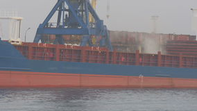 Cargo ships on the pier swims past. cargo ship, port, ships stock video footage