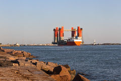 Cargo ships returning to shore along the Gulf coast. Freight ships returning to shore along the Gulf of Mexico in Port Aransas, Texas stock images